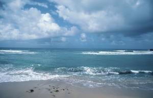 Blue-green beach, clouds